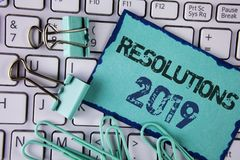 Handwriting text Resolutions 2019. Concept meaning Positive reinforcement personal improvent corporate goals written on Sticky Not. Handwriting text Resolutions Royalty Free Stock Images