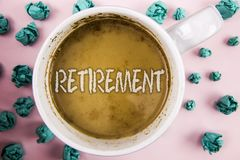 Handwriting text Retirement. Concept meaning Leaving Job Stop Ceasing to Work after reaching some age written on Coffee in White C. Handwriting text Retirement Stock Photography