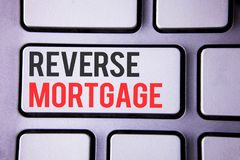 Handwriting text Reverse Mortgage. Concept meaning Elderly homeowner retirement option regular payment benefit written on white ke. Handwriting text Reverse Royalty Free Stock Photos