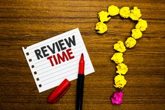 Handwriting text Review Time. Concept meaning situation or system its formal examination by people authority Paper marker crumpled. Papers forming question mark royalty free stock photo