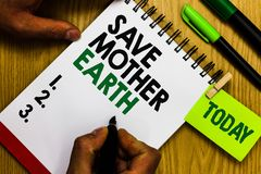 Handwriting text Save Mother Earth. Concept meaning doing small actions prevent wasting water heat energy Diary pen notepad ring p. En marker pointer script stock photo