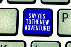Handwriting text Say Yes To The New Adventure. Concept meaning Exploring the world traveling life experience Keyboard. Key Intention to create computer message stock photography