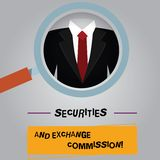 Handwriting text Securities And Exchange Commission. Concept meaning Safety exchanging commissions financial Magnifying. Glass photo Enlarging Inspecting a stock illustration