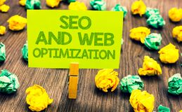 Handwriting text Seo And Web Optimization. Concept meaning Search Engine Keywording Marketing Strategies Paperclip retain written. Words yellow paper paper lobs royalty free stock images