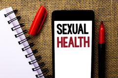 Handwriting text Sexual Health. Concept meaning STD prevention Use Protection Healthy Habits Sex Care written on Mobile Phone on t. Handwriting text Sexual stock image