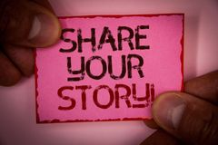 Handwriting text Share Your Story Motivational Call. Concept meaning Experience Nostalgia Memory Personal Words written pink paper. Note red border fingers Royalty Free Stock Images
