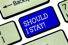 Handwriting text Should I Stay. Concept meaning Looking for reasons to remain on a place Doubtful Indecision Keyboard. Key Intention to create computer message stock image