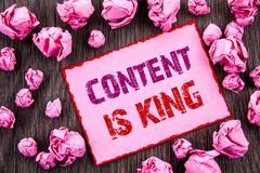 Handwriting text showing Content Is King. Business photo showcasing Online Marketing Information Management With cms Or Seo Data w. Ritten Pink Sticky Note Paper stock photo