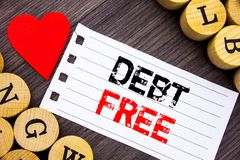 Handwriting text showing Debt Free. Conceptual photo Credit Money Financial Sign Freedom From Loan Mortage written on tear note pa. Handwriting text showing Debt Royalty Free Stock Images