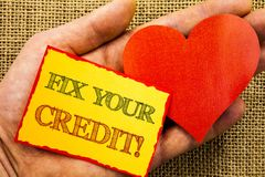 Handwriting text showing Fix Your Credit. Business concept for Bad Score Rating Avice Fix Improvement Repair written on Sticky Not. Handwriting text showing Fix Royalty Free Stock Photos