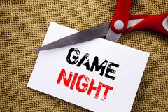 Handwriting text showing Game Night. Conceptual photo Entertainment Fun Play Time Event For Gaming written on Sticky Note Paper Cu. Handwriting text showing Game royalty free stock photo