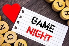 Handwriting text showing Game Night. Conceptual photo Entertainment Fun Play Time Event For Gaming written on tear note paper stic. Handwriting text showing Game royalty free stock image