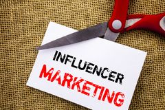 Handwriting text showing Influancer Marketing. Conceptual photo Social Media Online Influence Strategy written on Sticky Note Pape royalty free stock photos