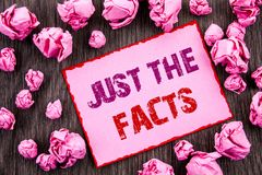 Handwriting text showing Just The Facts. Business photo showcasing Truth Fact Accuracy Honest Concept For Factual Actual  written. Pink Sticky Note Paper Folded Royalty Free Stock Images