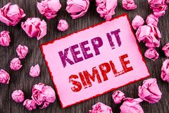 Handwriting text showing Keep It Simple. Business photo showcasing Simplicity Easy Strategy Approach Principle written on Pink Sti. Handwriting text showing Keep Stock Photography