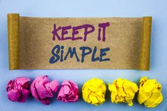 Handwriting text showing Keep It Simple. Concept meaning Simplicity Easy Strategy Approach Principle written on tear sticky note P. Handwriting text showing Keep Stock Images