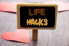 Handwriting text showing Life Hacks. Business photo showcasing Solution Hacking Hack Trick To Help Efficiency written on blackboar. Handwriting text showing Life Royalty Free Stock Photos