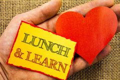 Handwriting text showing Lunch And Learn. Business concept for Presentation Training Board Course written on Sticky Note Paper Wit. Handwriting text showing Royalty Free Stock Photo