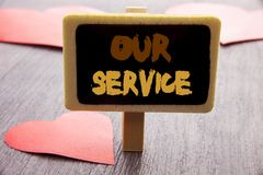 Handwriting text showing Our Service. Business photo showcasing Customer Marketing Support Help Concept Helping Your Client writte. N blackboard the wooden Royalty Free Stock Images
