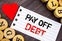 Handwriting text showing Pay Off Debt. Conceptual photo Reminder To Paying Owed Financial Credit Loan Bills written on tear note p. Handwriting text showing Pay Stock Photos