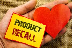 Handwriting text showing Product Recall. Business concept for Recall Refund Return For Products Defects written on Sticky Note Pap Stock Photography