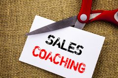 Handwriting text showing Sales Coaching. Conceptual photo Business Goal Achievement Mentoring written on Sticky Note Paper Cutting. Handwriting text showing Stock Photos