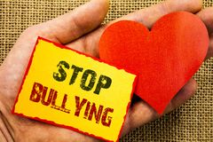 Handwriting text showing Stop Bullying. Business concept for Awareness Problem About Violence Abuse Bully Problem written on Stick. Handwriting text showing Stop Stock Image