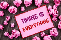 Handwriting text showing Timing Is Everything. Business photo showcasing Important Success Advice To Be Ready For Precision writte. N Pink Sticky Note Paper royalty free stock photos