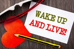 Handwriting text showing Wake Up And Live. Business concept for Motivational Success Dream Live Life Challenge written on Sticky n. Handwriting text showing Wake Royalty Free Stock Photography