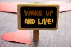 Handwriting text showing Wake Up And Live. Business photo showcasing Motivational Success Dream Live Life Challenge written on bla. Handwriting text showing Wake Royalty Free Stock Images