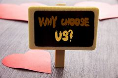 Handwriting text showing Why Choose Us Question. Business photo showcasing Reason Of Choice Customer Satisfaction Advantage writte. N blackboard the wooden Royalty Free Stock Photo