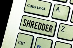 Handwriting text Shredder. Concept meaning machine or other device for shredding something like paper.  royalty free stock photo