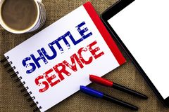 Handwriting text Shuttle Service. Concept meaning Transportation Offer Vacational Travel Tourism Vehicle written on Notebook Book. Handwriting text Shuttle Stock Image