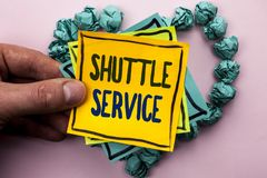 Handwriting text Shuttle Service. Concept meaning Transportation Offer Vacational Travel Tourism Vehicle written on Sticky Note Pa. Handwriting text Shuttle Stock Photo