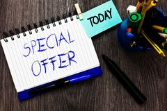 Handwriting text Special Offer. Concept meaning Selling at a lower or discounted price Bargain with Freebies Open notebook clothes. Pin holding reminder cup stock photos