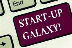 Handwriting text Start Up Galaxy. Concept meaning Newly emerged business created by new entrepreneurs Keyboard key Intention to stock image