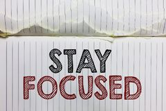 Handwriting text Stay Focused. Concept meaning Be attentive Concentrate Prioritize the task Avoid distractions Open notebook page. Crumpled papers ripped pages royalty free stock photos