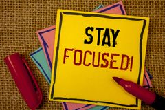 Handwriting text Stay Focused Motivational Call. Concept meaning Maintain Focus Inspirational Thinking. Handwriting textss Stay Focused Motivational Call stock image
