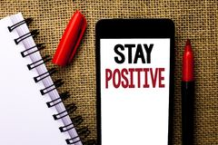 Handwriting text Stay Positive. Concept meaning Be Optimistic Motivated Good Attitude Inspired Hopeful written on Mobile Phone on. Handwriting text Stay Positive Stock Photo