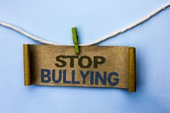 Handwriting text Stop Bullying. Concept meaning Do not continue Abuse Harassment Aggression Assault Scaring written on Cardboard P. Handwriting text Stop Royalty Free Stock Image