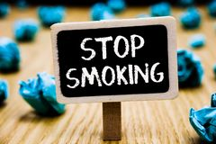 Handwriting text Stop Smoking. Concept meaning Discontinuing or stopping the use of tobacco addiction Blackboard crumpled papers s. Everal tries mistake not royalty free stock photography