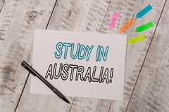 Handwriting text Study In Australia. Concept meaning going into foreign country order complete your studies Plain note stock photo