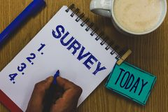 Handwriting text Survey. Concept meaning Questioning group of people to gather opinion on a particular subject Mug coffee paper ma. Rker pens nice art clip stock photos