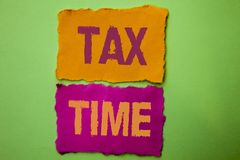 Handwriting text Tax Time. Concept meaning Taxation Deadline Finance Pay Accounting Payment Income Revenue written on Tear Papers. Handwriting text Tax Time royalty free stock photos
