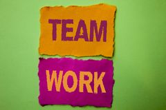 Handwriting text Team Work. Concept meaning Cooperation Together Group Work Achievement Unity Collaboration written on Tear Papers. Handwriting text Team Work stock image