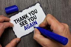 Handwriting text Thank You See You Again. Concept meaning Appreciation Gratitude Thanks I will be back soon Gray wooden deck hand. Hold black marker written royalty free stock photos