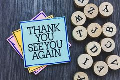 Handwriting text Thank You See You Again. Concept meaning Appreciation Gratitude Thanks I will be back soon Black wooden deck writ. Ten sticky note beside some royalty free stock photo