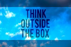 Handwriting text Think Outside The Box. Concept meaning Be unique different ideas bring brainstorming Multiline text desktop natur. Al blue sky cloudy background stock photography