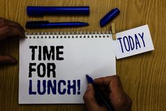 Handwriting text Time For Lunch. Concept meaning Moment to have a meal Break from work Relax eat drink rest Man holding marker not. Ebook clothespin reminder stock image