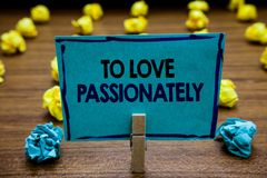 Handwriting text To Love Passionately. Concept meaning Strong feeling for someone or something else Affection Blurry wooden deck y. Ellow and blue lob on ground Stock Photography